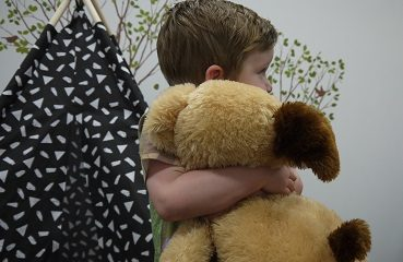 Child with a teddy bear