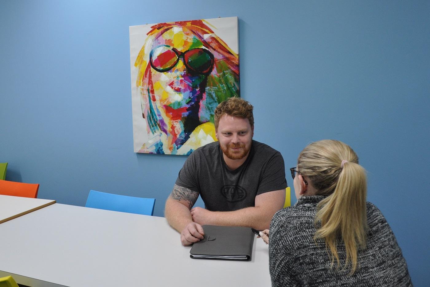 A Navigator Program team member with a client